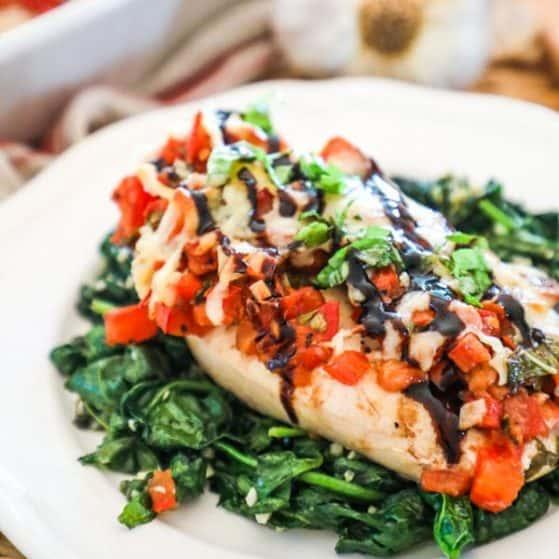 Bruschetta Chicken served with spinach