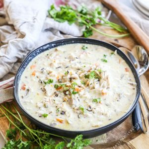 Crock Pot Chicken Wild Rice Soup Recipe plated in a bowl with parsley