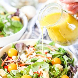 Homemade Lemon Vinaigrette poured over a salad
