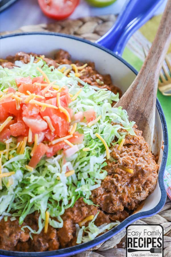 Easy Cheesy Taco Skillet topped with lettuce and tomatoes