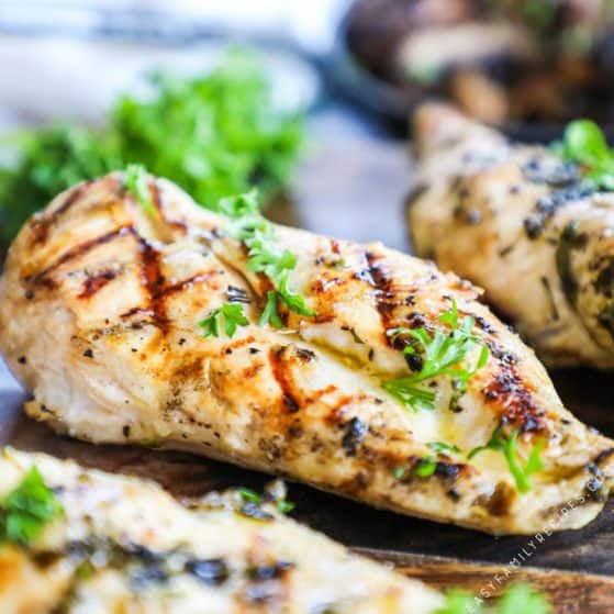 Perfectly Grilled Chicken Breast garnished with parsley and Marinated in Apple Cider Vinegar to be tender and juicy