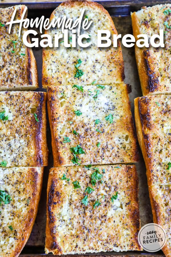 Homemade Garlic Bread Sliced on Baking Sheet