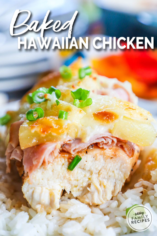 Hawaiian Chicken baked, plated and cut to show the layers of chicken, BBQ sauce, pineapple and cheese