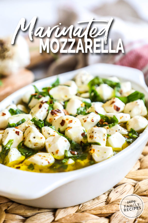 Mozzarella Marinating in olive oil, herbs, and spices in a dish