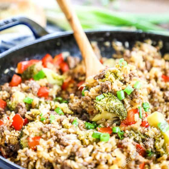 Easy Teriyaki ground beef and rice skillet recipe served with a wooden spoon