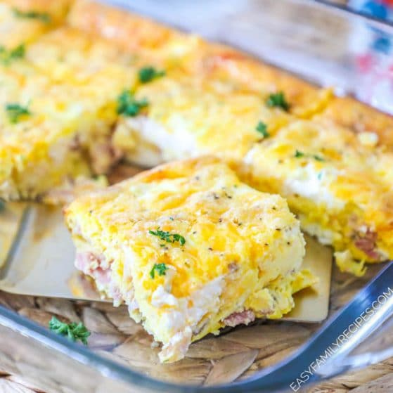 Slice of low carb breakfast casserole in casserole dish