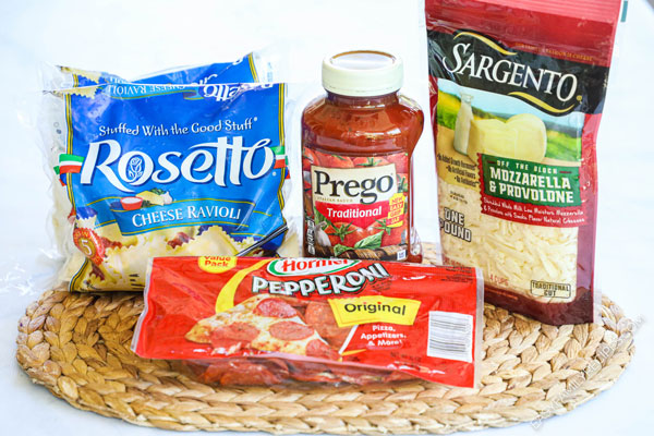 Ingredients for making Ravioli Lasagna including frozen ravioli, marinara sauce, pepperoni, and cheese