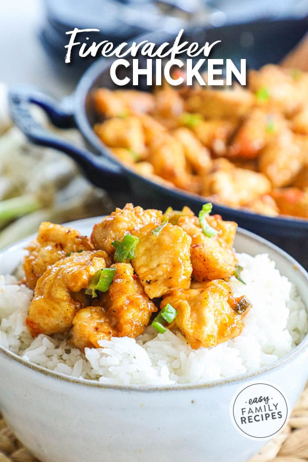 Firecracker chicken in a bowl over rice