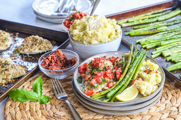 Bruschetta Chicken with a crispy mozzarella crust served with roasted asparagus and bacon mashed potatoes