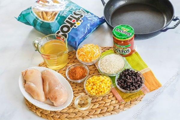 Ingredients to make chicken burrito bowl in skillet