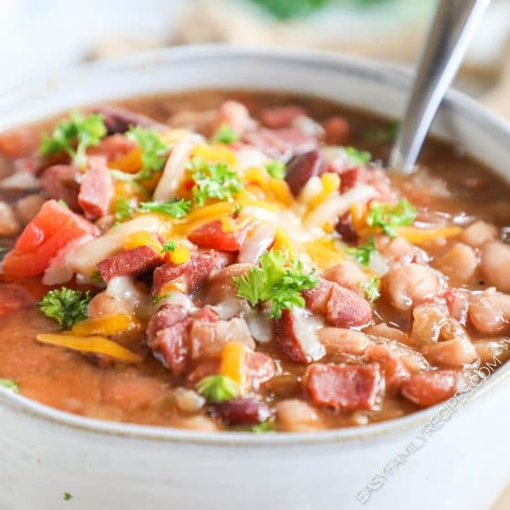 Easy 15 bean soup served in a bowl and garnished with cheese