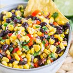 Close up of a bowl of corn and black bean salsa