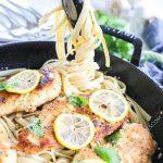 Lifting lemon basil pasta to serve this hearty pasta dinner