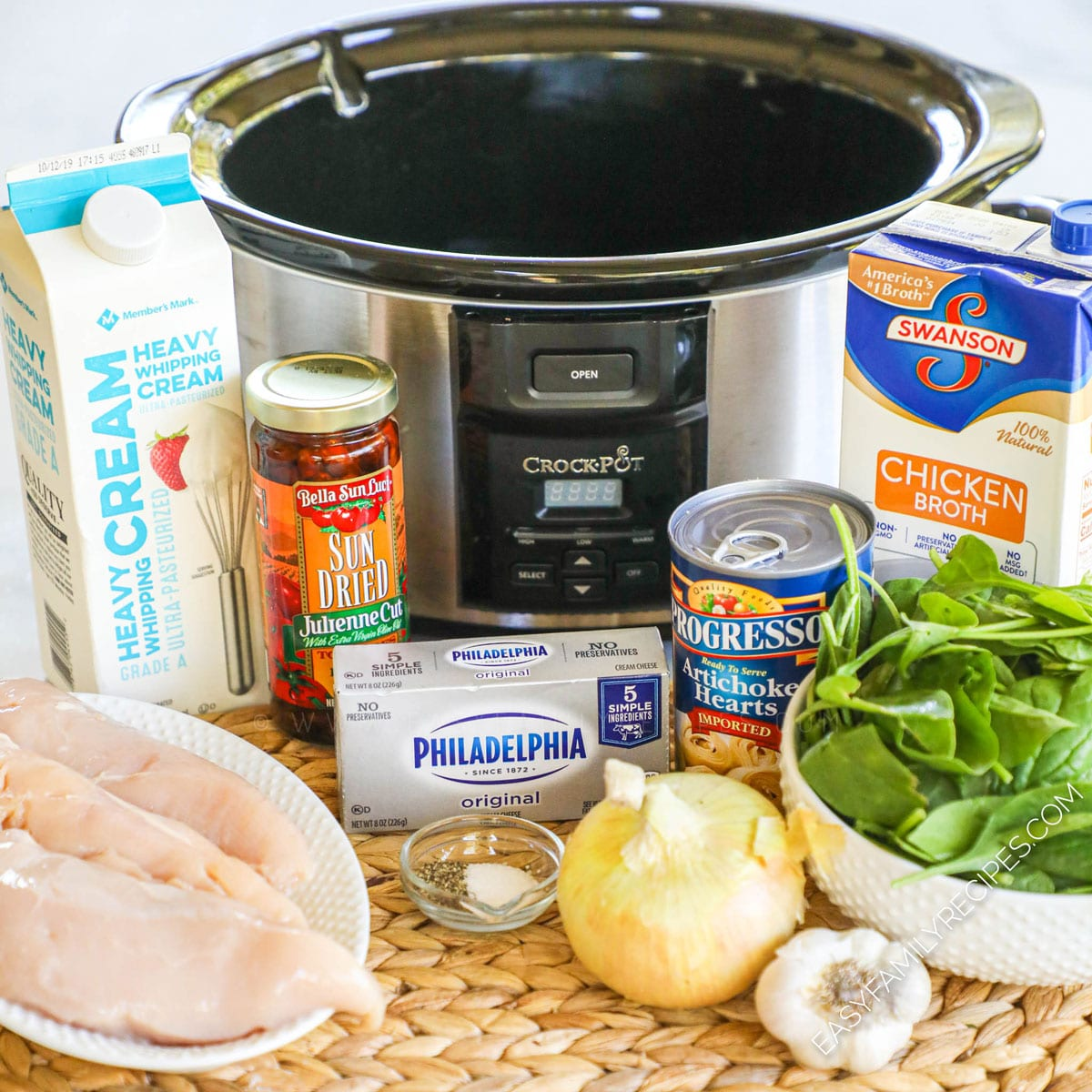 Ingredients for Tuscan Chicken Soup including chicken breast, spinach, artichokes, sun dried tomatoes, garlic, onion
